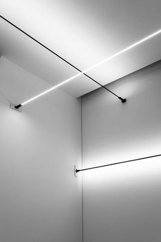 lighting design Flash by Davide Groppi is a 9 mm thick stainless steel lighting strip, which can extend up to 12 metre in length. It casts a most dramatic shadow. Home Lighting Design, Lighting Concepts, Cool Lighting, Strip Lighting, Interior Lighting, Modern Lighting, Pendant Lighting, Architectural Lighting Design, Lighting System