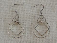 Silver Color Fish Hook Dangle Earrings by StitchMetal on Etsy, $7.00