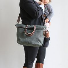 Our Crossbody Zipper Tote is a rugged bag for everyday adventures. This unstructured bag is a perfect option as an everyday crossbody or a small diaper tote to keep snacks and sippy cups within reach. The split exterior pockets are riveted for stability, hold a small water bottle or