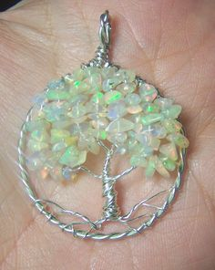 Opal Tree of Life pendant.- Ethiopian Opal - Welo Opal - Wello Opal - necklace pendant -  Sterling Silver jewelry pendant, comes with chain. $100.00, via Etsy.