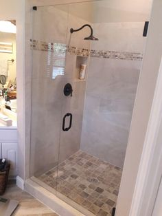 Inline frameless shower with a door and stationary panel, BM Style handle in Oil Rubbed Bronze finish Frameless Shower Enclosures, Inline, Bronze Finish, Oil Rubbed Bronze, Stationary, Bathtub, Handle, Doors, Bathroom