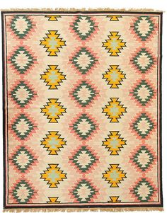 Love this pastel-colored Aztec rug for a cool nursery...