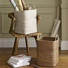 """Sturdy storage for magazines, media and more. The durable frames of our Modern Weave Handled Baskets are covered in tightly handwoven rattan peel and stained to highlight its rich texture. • 12.5""""sq x 19.25""""h. • Handwoven rattan…"""
