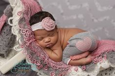african american newborn girl curved bench pink and gray