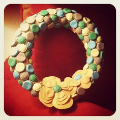 Bottle cap wreath. I got the wreath itself for a dollar at the thrift store. I gathered the bottle caps while volunteering at a beer festival. I used the cheapest craft paint from Walmart. And one piece of felt ($.23). All in all I spent less than $5.