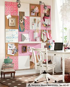 desk area with giant cork board