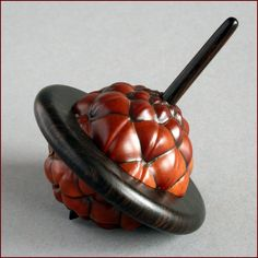 "Wood, Jakob Weissflog, Artist, spinning top, 2012, african blackwood, thika fruit, 3.188""h x 2.5"" dia"