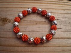 Orange Pave Crystal and Tibetan Silver Bead Stretch Bracelet on Etsy, $17.00