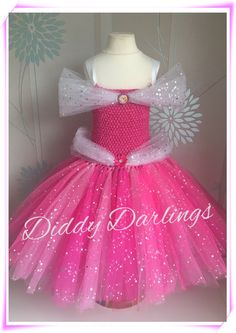 Sparkly Sleeping Beauty Tutu Dress. Sparkly Aurora Tutu Dress. Beautiful & lovingly handmade.  All characters and colours available Price varies on size, starting from £25.  Please message us for more info.  Find us on Facebook www.facebook.com/DiddyDarlings1 or our website www.diddydarlings.co.uk