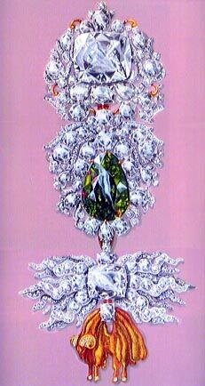 The Golden Fleece ornament with the Dresden White diamond (top). The center third of the   ornament which encompasses the Dresden Green diamond was saved from disassembly and remains part of the present ornament.