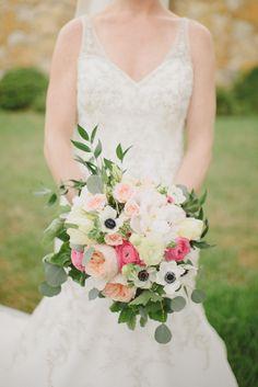Gorgeous garden style bouquet of peonies, garden roses, spray roses, ranunculus, lisianthus, anemones, eucalyptus, ruscus, and geranium