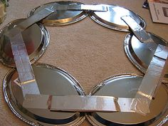 good idea--oval trays from dollar store for background...Fake-It Frugal: Silver Platter Wreath