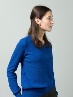 WOLFEN GERMANY / The round neck sweater with special pattern in front has been knitted from 100% lambswool.