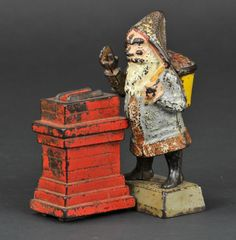 SANTA CLAUS MECHANICAL BANK for auction., designed by Charles Shepard & Peter Adams, patented Place a coin in Santa's hand, press the lever, and he tosses the coin into the chimney. What Is Christmas, Christmas Past, Father Christmas, Vintage Christmas, Antique Coins, Antique Metal, Vintage Santas, Vintage Toys, Saint Nick