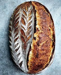I don't have a signature score yet, but I'd say a single slash plus some sort of leaf pattern is my go-to. Sourdough Recipes, Loaf Recipes, Sourdough Bread, Artisan Boulanger, Bread Shaping, Bread Art, Artisan Bread, Quick Easy Meals, Recipe Tips