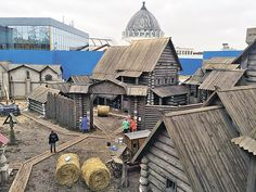 "shot series about life in Moscow in the 15th century  Wooden decorations erected directly on the territory ENEA (in the background - a glass pavilion ""Electrification"")."