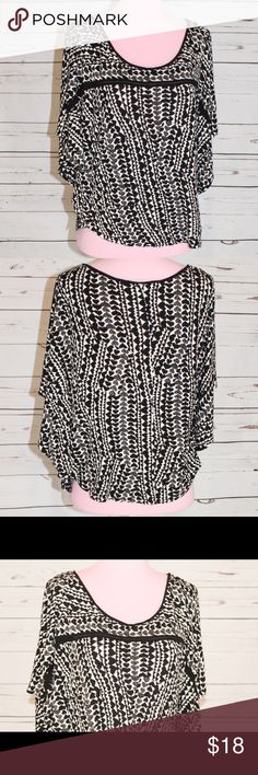 H&M Black and White Heart Print Batwing Top This is a heart print Batwing Top from H&M. Size large. Flows and comfortable. Very good used condition. H&M Tops