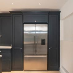 A large American fridge-freezer has been designed into the kitchen cabinetry wit… A large American fridge-freezer has been designed in kitchen cabinets with lots of storage around it. The units were painted in Little Greene Basalt Kitchen Wall Units, Kitchen Cupboard Designs, Bedroom Cupboard Designs, Kitchen Design, Kitchen Ideas, Kitchen Inspiration, Cheap Kitchen, Kitchen Layout, Kitchen Stuff