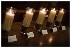 Memorial table with photos, candles and flowers for the deceased or absent relative: