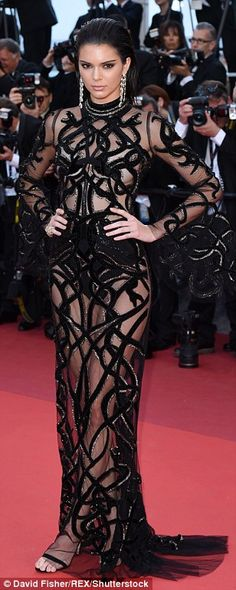 The 20-year-old reality starlet-turned-supermodel sizzled in a dramatic sheer gown with intricate detailing while flashing her high-waisted underwear and bare chest