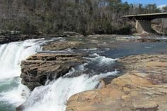 The Singing River Waterfalls  Native Americans named the Tennessee River that rolls through The Shoals area The Singing River. The Singing River Waterfalls Day Trip features Coldwater Falls as the centerpiece of beautiful Spring Park in Tuscumbia and the beautiful Wilson Dam waterfall. #visitnorthal #waterfalls