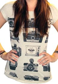 Vintage Tech Tee  $21.50  This heathered oatmeal and gray tee has images of vintage cameras, watches and televisions turned on to some crazy old channels. You love the soft, stretchy cotton and add a fuzzy knit sweater, frayed cut offs and tights to add texture and interest to this comfy, vintage look.