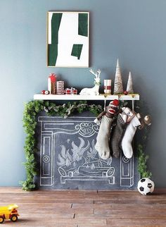 No fireplace? No problem! Hang stockings from a floating shelf stacked above a chalk-drawn fire for that Christmas mantel feel at a fraction of the price of installing a real fireplace. Source: Target via Apartment Therapy Fireplace Drawing, Fake Fireplace, Christmas Fireplace, Christmas Mantels, Christmas Stockings, Christmas Holidays, Christmas Crafts, Christmas Decorations, Holiday Decor