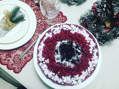 Christmas cake decor with berries and coconut flakes