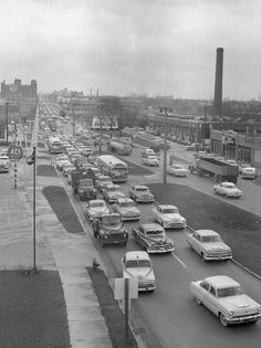 Milwaukee, Wisconsin, 1950s-View looks to the east on Wisconsin Avenue at about 45th Street.2 GM old look buses clearly in view among all the autos.