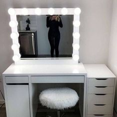 DESCRIPTION Large makeup mirror with lights for every makeup lover. Have a wonderful professional makeup experience! SIZE Entire mirror is 30 tall x 36 wide x 2.25 deep and the mirror size is 24 x 30 BULB SIZE Socket size is E26 which is a standard bulb socket. COLOR We can do any