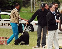Bo Obama  First lady Michelle Obama hands the family dog Bo to her husband President Barack Obama as they leave a school in D.C. on Sept. 26, 2009, where their daughter Malia played a soccer game.