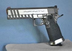 Infinity .45  -  Not that it will ever be in my hands, but what a sweet 1911.