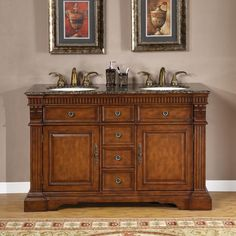This double-sink bathroom vanity is a unique addition to your home and comes with the ceramic sinks. Antique brass accent door knobs help to tie in the antique feel of this vanity.