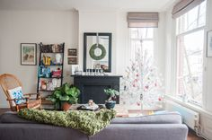 A relaxed, bohemian-inspired living room designed to escape the hustle and bustle of city life and decorated for the holidays.