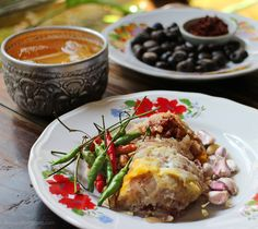Northern Thai food. Sausage & egg; black mushrooms with chili dip and passion fruit drink.