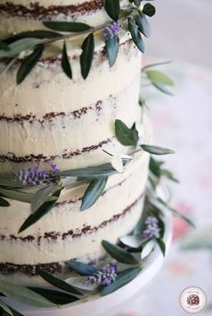 Tuscan Semi Naked Wedding Cake   Tuscan-inspired cake, decorated with olive branches and lavender for wedding at @Masialagarriga (Wedding Cake With Cupcakes)