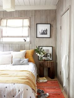 This bedroom has wood-paneled walls done right: weathered and beautiful.