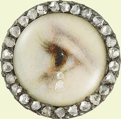 Eye of a lady  c.1905  Watercolour on ivory; set in a diamond-mounted stickpin  Dia. (miniature): 1.1 cm  First recorded in the Royal Collection during the reign of King Edward VIII