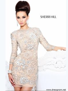 This Sherri Hill short prom dress with long sleeves offers a unique and sophisticated look. Check out all the 2014 prom dresses at DressProm.net.