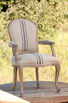 "Add a classic element to your dining room with this beautiful linen striped upholstered arm chair. 39"" x 24"" x 19"" This is a special order item and may take 6 weeks for shipment."