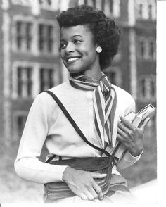 Thelma Porter carrying her books as Miss Subways, 1948. Porter became the first black Miss Subways, more than three decades before Vanessa Williams became the first black Miss America in 1983. Women of all races competed against one another until the pageant ended in 1976.