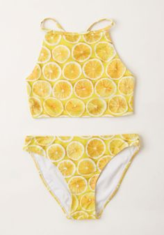 Zest Day Ever Swimsuit Top. The bright yellow lemons on your swimsuit top by British cult brand Motel are just as refreshing as that first dive into the water! #yellow #modcloth