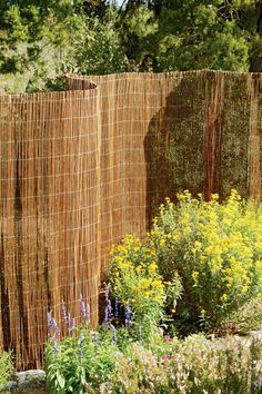 I like this idea!  Camouflage chain link fence... Willow Garden Fencing | Buy from Gardener's Supply