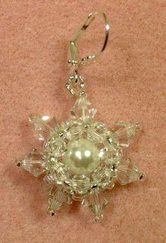 Materials List: 2- 8mm round beads 14- 6mm bicone crystals 14- 4mm bicone crystals 15/o, 11/o, 8/o seed beads 2- ear wires size ten beading needle 8lb Fireline