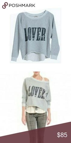 """Lover Sweatshirt 80s inspired slouchy premium sweatshirt from Haute Hippie. Pre-shrunk and fitted for feminine silhouette. Slight high-low drop. Very soft and comfy material. •About 27"""" from shoulder to hem •Rayon/elastane •Hand wash or dry clean Haute Hippie Tops Sweatshirts & Hoodies"""