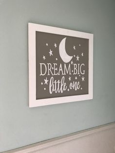 "24 x 24 inch grey sign with white frame reading in white ""Dream big little one"" with stars and a half moon.   Customize the sign to fit your nursery theme! Sign comes ready to hang!"