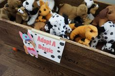Swell Parties: {It was a PAWTY: Turning Two!} Puppy Party Ideas for kids and toddlers. Adopt a dog stuffed dogs with babies. Party favors. Oriental Trading. Girl birthday party.