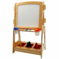 """Anatex Easel Standing by Anatex. $154.50. Sturdy construction. Made in the USA. Made of plywood. Ages 36 mo and up. From the Manufacturer                Our Standing Easel is beautifully designed and made of the highest-quality wood and is the perfect art center for crafty kids. It features a dry-erase board on one side and a chalkboard on the other side, as well as a dowel on the top to put a roll of 18"""" easel paper (1 roll included) for endless drawing, paint..."""
