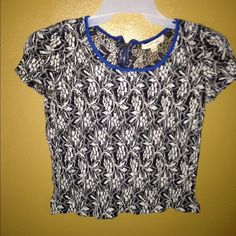 Cropped Shirt Cute cropped shirt black & white with blue around the top. Also has a zipper on the back :) tag says large fits like a small. Tops Crop Tops