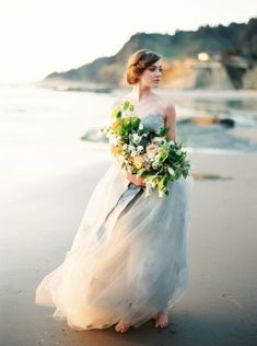 blue wedding dress bride on beach